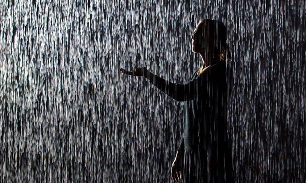 Visitors explore 'Rain Room' by artists Random International, a 100 square metre field of falling water which parts as visitors walk underneath, at the Barbican, in central London. PRESS ASSOCIATION Photo. Picture date: Wednesday October 3, 2012. Photo credit should read: Dominic Lipinski/PA Wire