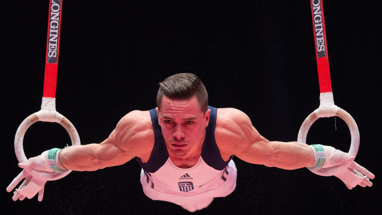 epa05005365 Eleftherios Petrounias of Greece performs during the men's rings finals on day nine at the 46th FIG Artistic Gymnastics World Championships in Glasgow, Britain, 31 October 2015.  EPA/ANDREW COWIE